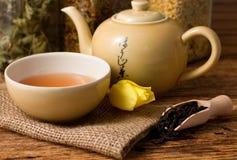 Oriental tea set on jute cloth and tulip bloom Stock Images