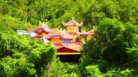 Oriental Temple Building Rooftop Among Tropical Vegetation HD Footage stock video