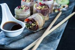 Oriental teriyaki beef bites on marble board Stock Images