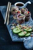 Oriental teriyaki beef bites on marble board Royalty Free Stock Photos