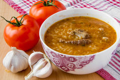 Oriental tomato soup. With meat, rice and cilantro Stock Photo