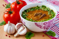 Oriental tomato soup. With meat, rice and cilantro Royalty Free Stock Images
