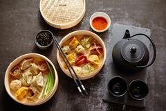Oriental traditional chinese dumplings served in the wooden steamer stock photography