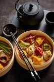 Oriental traditional chinese dumplings served in the wooden steamer royalty free stock photography
