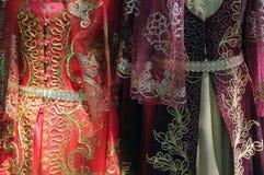 Oriental traditional dresses Stock Photos