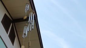 Oriental wind bells ringing with blue sky stock video
