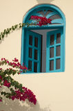 Oriental window. Picture of an oriental blue window with red flowers Stock Image