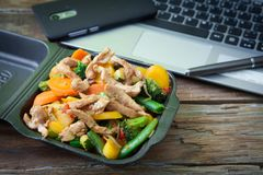 Vegetable oriental food. Oriental wok vegetables to eat at work with chicken Stock Photography