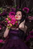 Oriental woman with flowers Stock Image