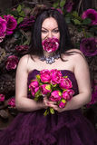 Oriental woman with flowers Stock Photography