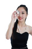 Oriental woman holding a big diamond to her eye Stock Photos