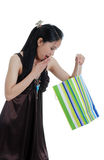 Oriental woman surprised by a present Stock Photo