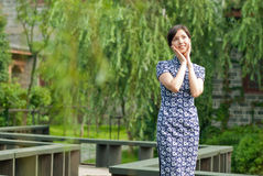 Oriental women wearing cheongsam-Willow shade of the zigzag bridge Stock Image
