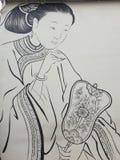 Orientale-Dame, die einen Fächer herstellt stockbild
