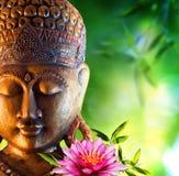 Orientalischer Hintergrund mit Buddha Stockfotografie
