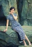Orientaliska kvinnor som bär cheongsam Royaltyfria Foton