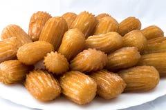 Orientaliska sötsaker på en vit bakgrund Bama Royaltyfria Bilder