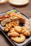 Orientaliska sötsaker på plattan Arkivbild