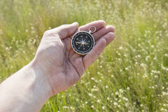 Orientation. A device that facilitates terrain orientation by reference to the magnetic poles of the Earth and the compass Royalty Free Stock Photography