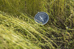 Orientation. A device that facilitates terrain orientation by reference to the magnetic poles of the Earth and the compass Royalty Free Stock Images