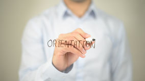Orientation , man writing on transparent screen Stock Photos