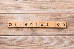 Orientation word written on wood block. Orientation text on wooden table for your desing, concept stock photo