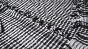 Oriente Medio marcó con cuadros el keffiyeh blanco y negro con las borlas, primer almacen de metraje de vídeo