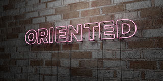 ORIENTED - Glowing Neon Sign on stonework wall - 3D rendered royalty free stock illustration. Can be used for online banner ads and direct mailers Royalty Free Stock Photo
