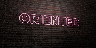 ORIENTED -Realistic Neon Sign on Brick Wall background - 3D rendered royalty free stock image. Can be used for online banner ads and direct mailers Royalty Free Stock Photography