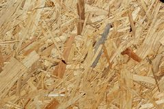 Oriented strand board osb background texture. Oriented strand board osb as a background texture royalty free stock photography