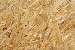 Oriented strand board osb background texture. Oriented strand board osb as a background texture royalty free stock photo