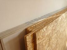 Oriented strand board and plaster board prepared for construction. Stock of oriented strand board and plaster board prepared for construction stock photography