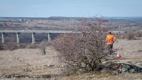 Orienteering. Check point Prism and electronic composter. Picturesque landscape with a bridge over a granite canyon. Orienteering. Check point Prism and royalty free stock images