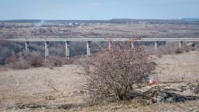 Orienteering. Check point Prism and electronic composter. Picturesque landscape with a bridge over a granite canyon. Orienteering. Check point Prism and stock image