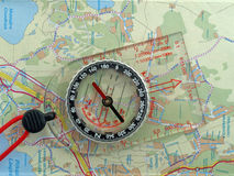 Orienteering compass on a map. Orienteering compass on a detailed map Stock Photo