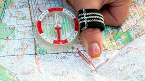 Orienteering. Compass and topographic map. The athlete uses navigation equipment for orienteering. The concept. Orienteering. Compass and topographic map. The royalty free stock photo