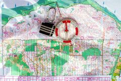 Orienteering. Compass and topographic map. Navigation equipment for orienteering. The concept.  stock images