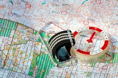Orienteering. Compass and topographic map. Navigation equipment for orienteering. The concept. Orienteering. Compass and topographic map. Navigation equipment Stock Images