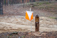Orienteering. Control point Prism and composter for orienteering in the autumn forest.  stock images