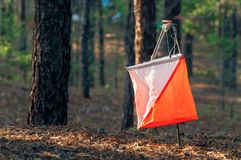 Orienteering. Control point Prism and composter for orienteering in the autumn forest. The concept. Orienteering. Control point Prism and composter for Stock Images