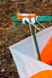 Orienteering. Control point Prism and composter for orienteering in the autumn forest. The concept. Orienteering. Control point Prism and composter for Royalty Free Stock Photo