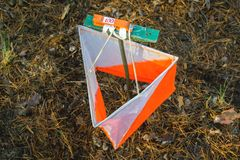 Orienteering. Control point Prism and composter for orienteering in the autumn forest. The concept.  stock photography