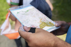 Orienteering in the forest. Selective focus. Man holding compass Royalty Free Stock Photos
