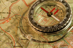 Orienteering: map and compass. Map and compass, ready for an outdoor adventure Royalty Free Stock Photo