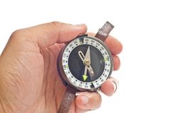 Orienting. Man's hand holding a compass. Isolated on white Stock Images