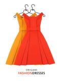 Origâmi vestidos de papel amarelos e do vermelho Imagens de Stock Royalty Free