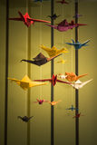 Origami. Garland with origami colored cranes Stock Photography