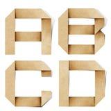 字母表工艺在被回收的origami纸张上写字 免版税库存图片