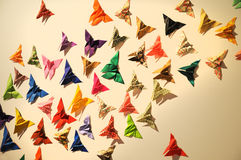Origami. A swarm  of colorful origami butterflies Stock Images