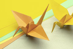 The Origami. In the Japan, Tsuru origami represents luck, peace, happiness and longevity Stock Photos